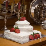 small wedding cake decorated with strawberries